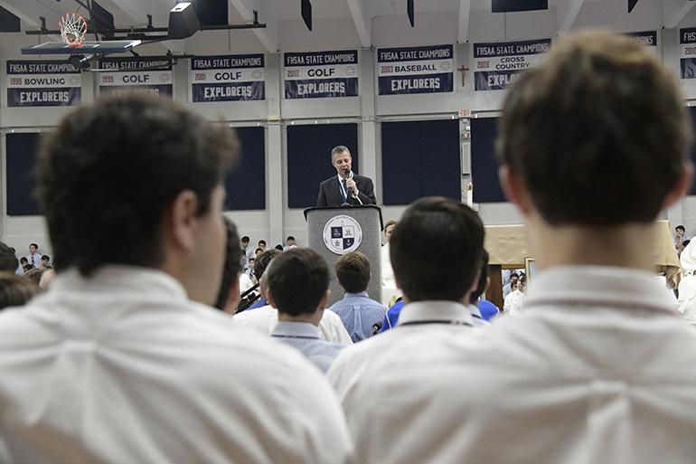 Students listen as Thomas G. Kruczek, Christopher Columbus High School's second president, pledges to