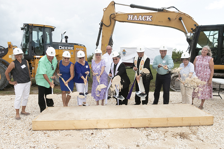 "Parishioners join Miami Auxiliary Bishop Enrique Delgado and Father Jesus ""Jets"" Medina, parish administrator, in the symbolic groundbreaking for the new church of St. Peter in Big Pine Key."