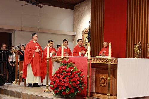 Archbishop Thomas Wenski presided at the Mass marking the opening of the academic year at the University of Miami. Priests concelebrating the Mass included, from left: Father Rafael Capo, of the Southeast Regional Office for Hispanics and Pastoral Juvenil Hispana; Father Elvis Gonzalez, archdiocesan director of vocations; Father Phillip Tran, Catholic chaplain at UM; Father Richard Vigoa, administrator of St. Augustine Church; and Jesuit Bishop Luis del Castillo, retired of Melo, Uruguay. The Mass took place at St. Augustine Church and Catholic Student Center, just across from the UM campus, Sept. 15, 2019.