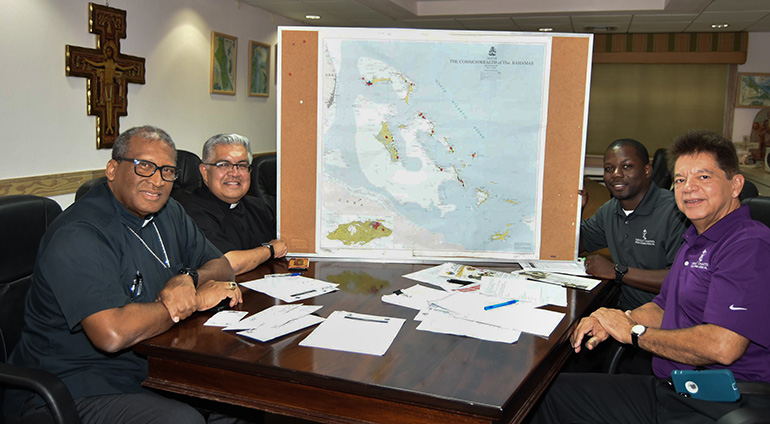 Nassau Archbishop Patrick Pinder, far left, meets with Msgr. Roberto Garza and Peter Routsis-Arroyo, front right, of Catholic Charities of the Archdiocese of Miami in Nassau Sept. 17.  With them, right rear, is Marco Greenslade, Catholic Charities' director of Finance, who was born and raised in the Bahamas.
