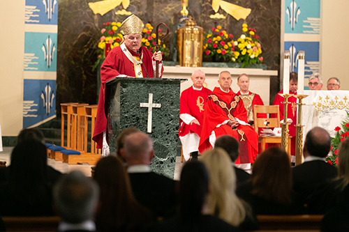 Archbishop Thomas Wenski preaches the homily at the 30th annual Red Mass of the Broward County-based St. Thomas More Society of South Florida, Sept. 26 at St. Anthony Church in Fort Lauderdale. Catholic judges, lawyers and other legal professionals attended the event.