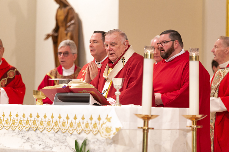 Archbishop Thomas Wenski is surrounded by concelebrating priests as he presides at the 30th annual Red Mass of the Broward County-based St. Thomas More Society of South Florida, Sept. 26 at St. Anthony Church in Fort Lauderdale. Catholic judges, lawyers and other legal professionals attended the event.
