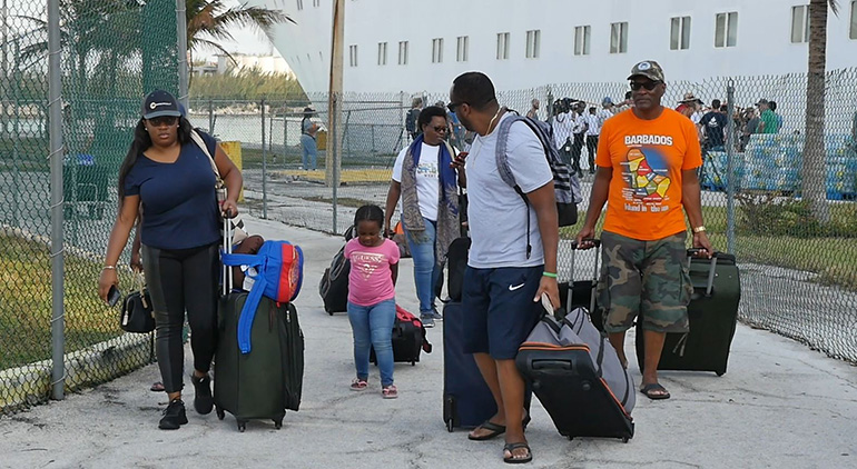 Some of the 200 Bahamian residents stranded in South Florida during Hurricane Dorian arrive in Freeport Sept. 6. Bahamas Paradise Cruise Line's Grand Celebration ferried them back on a humanitarian mission that also brought more than 1,100 evacuated Bahamian and American residents  to the Port of Palm Beach Sept. 7.