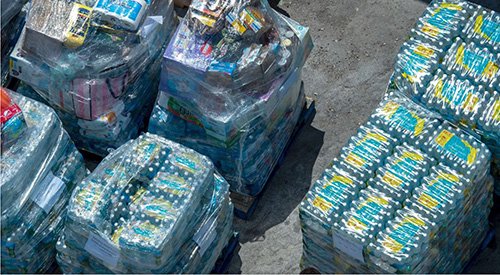 Pallets of water bottles were among the more than 225,000 pounds of supplies delivered to Freeport, Bahamas, by Bahamas Paradise Cruise Line's Grand Celebration. The ship sailed from Palm Beach the evening of Sept. 5 and returned Sept. 7 with more than 1,100 evacuees, fleeing from the ravages of Hurricane Dorian.