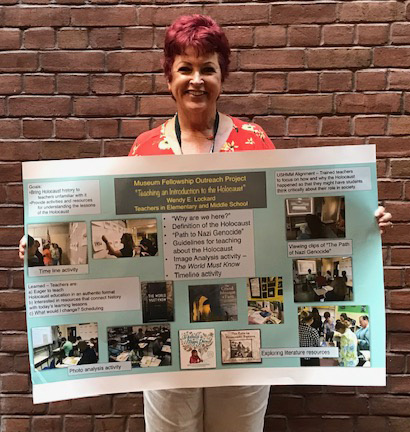 "St. Jerome School teacher Wendy Lockard holds up her project on ""Teaching the Holocaust to Middle School Teachers†and ""The Lessons of the Holocaust to Elementary Teachers.†She successfully completed a Museum Teacher Fellowship at the U.S. Holocaust Memorial Museum in Washington, D.C."