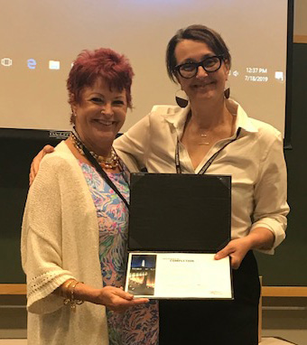 St. Jerome School teacher Wendy Lockard, left, receives her certificate as a Museum Teacher Fellow from the U.S. Holocaust Memorial Museum in Washington, D.C.