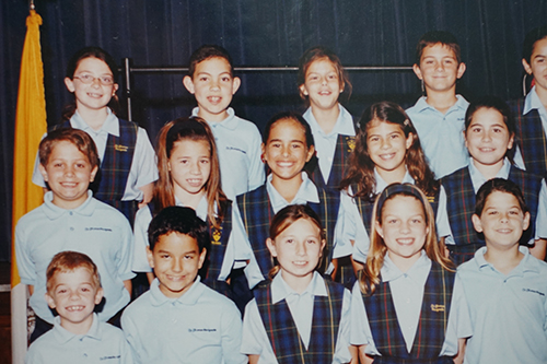A class photo of Olympic gold medalist and tennis pro Monica Puig (second row, third student), when she was in the third grade at St. Thomas the Apostle School, Miami.