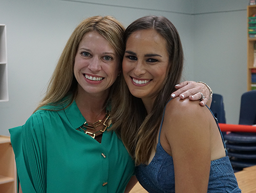 Back in third grade: St. Thomas the Apostle School Principal Lisa Figueredo and former student Monica Puig pose together in the classroom in their old classroom. Before becoming principal, Figueredo was Puig's third grade teacher.