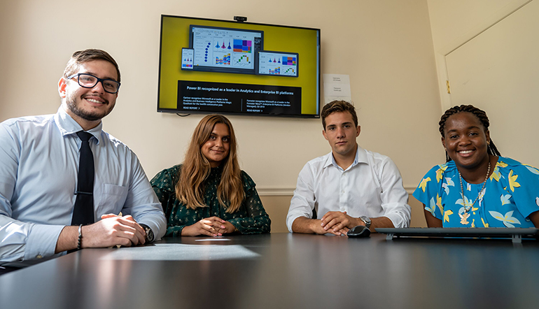 From left,  St. Thomas University students in data analytics: 