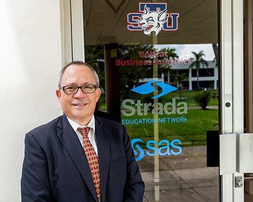 Jose Rocha, assistant professor of management at STU's Gus Machado School of Business, directs the Bobcat Business Analytics Enterprises Services, named after the school's mascot.