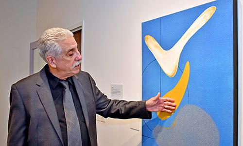 Emilio Hector Rodriguez explains his painting