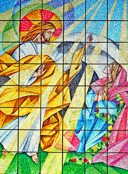 The risen Jesus appears to Mary Magdalene in this mosaic at the Lakeside Chapel, part of Our Lady of Mercy Cemetery in Doral.