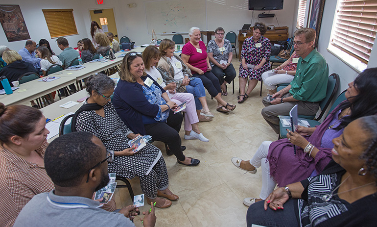 During a breakout session, participants in the bereavement ministry training look at photos and then describe what the photos mean to them during the bereavement ministry training day held at St. Agnes Church, Key Biscayne, Sept. 14.