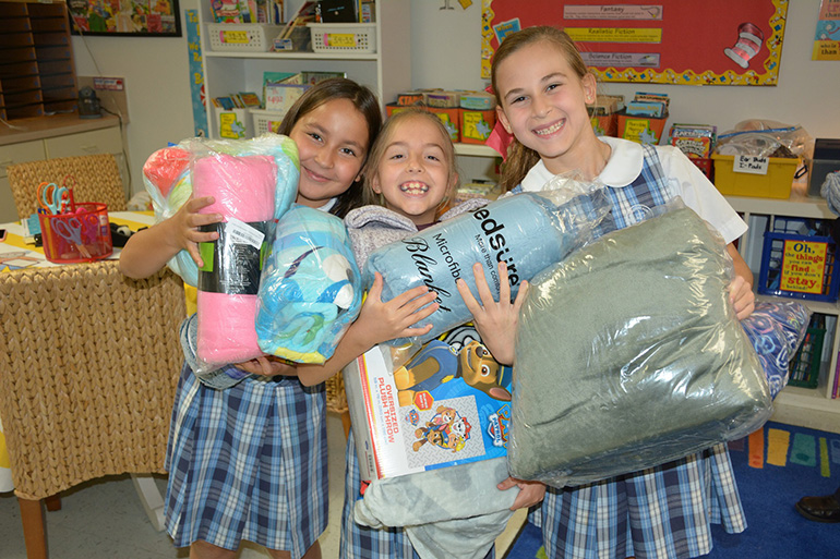 St. Agnes Academy third graders donate blankets for the Blanket Drive.