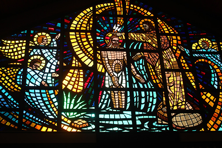 A large stained glass  window featuring an image of St. John the Baptist baptizing Jesus is a beautiful addition to St. John the Baptist Church in Fort Lauderdale and pays tribute to its patron saint, known for being a great evangelist.