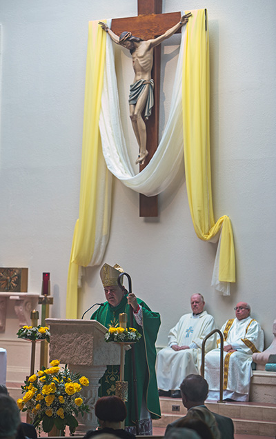 Archbishop Thomas Wenski preaches the homily during the triple anniversary Mass he celebrated at Holy Rosary-St. Richard Church Oct. 5: 60 years of Holy Rosary's establishment, 50 years of St. Richard's establishment and 30 years of the construction of St. Richard Church.