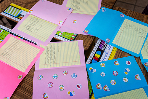 Joye Ritchie-Greene, principal at Mary, Star of the Sea Catholic Academy in Freeport, Grand Bahama, reviews pen-pal letters sent from students at St. Cecilia Catholic School in Dallas, Texas, to the traumatized students in the Bahamas following the historic Hurricane Dorian, which made landfall Sept. 1-3.