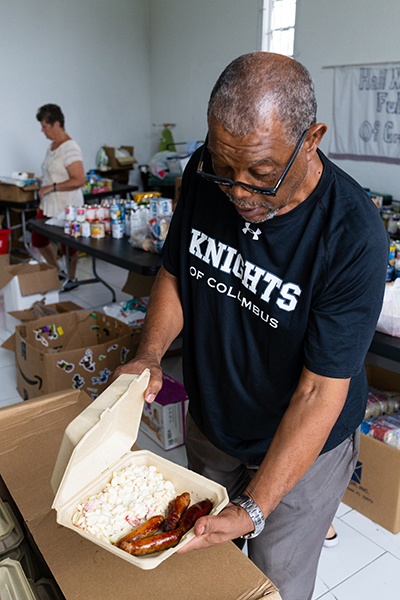 Patrick Ferguson, a retired national radio broadcaster in the Bahamas and a longtime member of Mary, Star of the Sea Parish in Freeport, prepares a hot meal for distribution Oct. 8, more than a month following Hurricane Dorian's impact in The Bahamas.