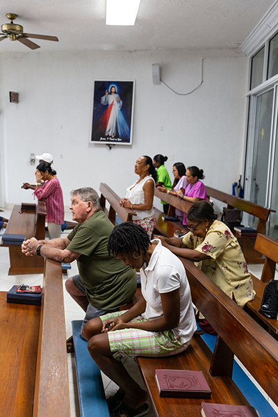 Parishioners gather for noon Mass at Mary, Star of the Sea Parish in Freeport Oct. 8, more than a month following Hurricane Dorian's impact in The Bahamas. The area was heavily damaged by Dorian's storm surge-flooding throughout Grand Bahama.