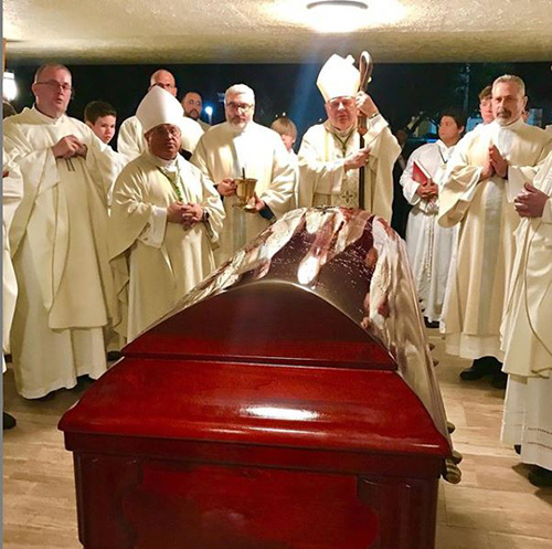 Archbishop Thomas Wenski, Auxiliary Bishop Enrique Delgado, archdiocesan priests and deacons bid a final farewell to Father Patrick Murnane after his funeral Mass at Nativity Church in Hollywood, where he served as pastor for nearly 30 years. The funeral was celebrated Oct. 11, 2019.
