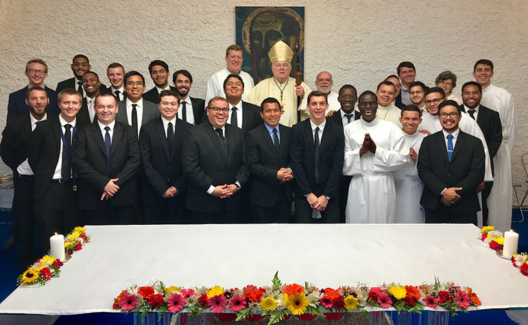 Archbishop Thomas Wenski with seminarians from Redemptoris Mater Seminary in Hialeah, after celebrating Mass with them Oct. 12, 2019.