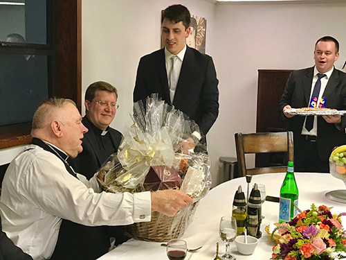 Archbishop Thomas Wenski receives a birthday gift from Redemptoris Mater seminarians after celebrating Mass with them Oct. 12, 2019. The archbishop's birthday is Oct. 18.
