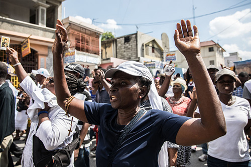 Catholic faithful demonstrate in a silent and non-violent march in Port-au-Prince against the Haitian government Oct. 22, 2019. Thousands of Catholics demanding the resignation of Haiti's president marched through the capital Tuesday, becoming the latest group to join an outcry against him. They gathered outside one of the main churches in Port-au-Prince and denounced President Jovenel Moise as corrupt and incompetent. (Photo by Valerie Baeriswyl / AFP via Getty Images)