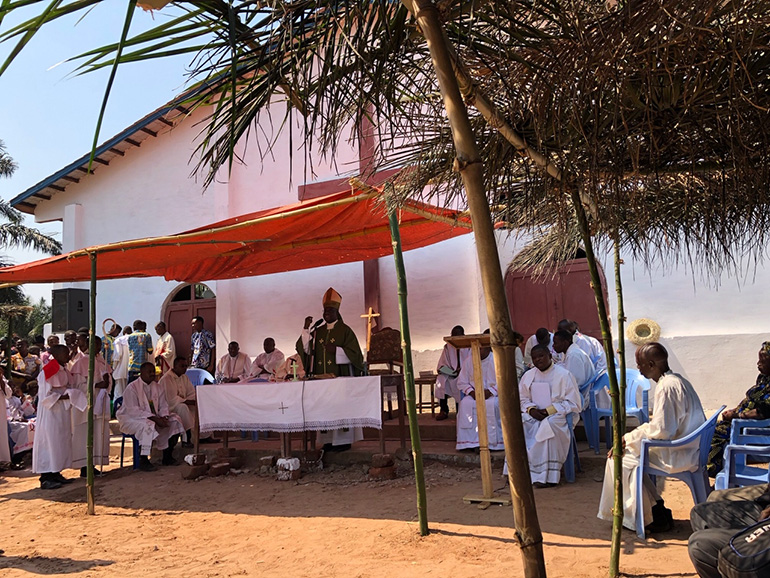 Bishop Emmanuel Bernard Kasanda of the Diocese of Mbuji-Mayi celebrates the Mass during which he dedicated the first church in the Kasai-Oriental village of Mpiana Nita.