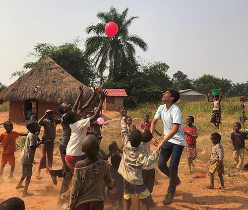 A young Hope for Kasai missionary from South Florida plays with children the village of Mpiana Nita, Democratic Republic of Congo. The organization has built a church, a sewing center, a maternity center and water collection and filtration systems since its founding in 2012.