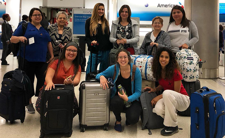 Amor en Accion missionaries gather for a group photo before departing to the Dominican Republic this summer. Among them are mother and daughter duo Jeanette Victoria and her mother, Lourdes Victoria (back row left).