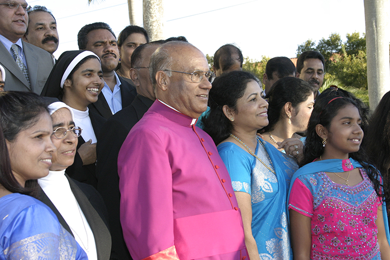 Msgr. James Parappally poses with members of the Indian Catholic community after the investiture ceremony for newly named monsignors, March 2, 2008. He was the first Indian priest to be made a monsignor in the archdiocese.