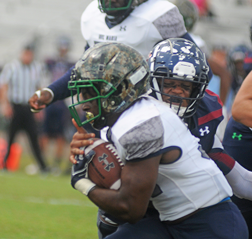 St. Thomas' Shariff Rodriguez (back) tackles Ave Maria running back Quino Mauricette during their football game on Oct. 26, 2019, at Msgr. Pace High School.