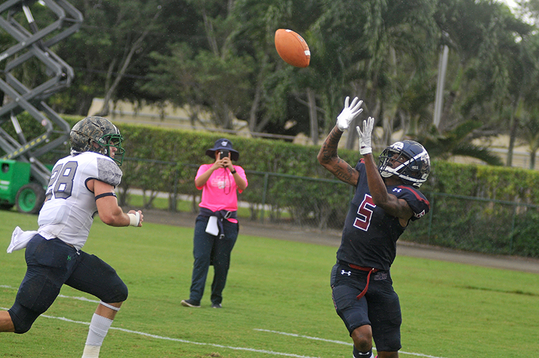 St. Thomas wide receiver D'Amaunte Oliver, right, catches a 15-yard touchdown pass over Ave Maria defender Dylan Bryan during the second quarter of their Mid-South Conference football game, Oct. 26, 2019 at Msgr. Pace High School.