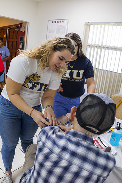 The Cuban Knights of Malta hosted a Health Fair at Our Lady of Charity National Shrine Nov. 2. Volunteers Sophia Menendez, left, and Ana Pinon from the FIU Herbert Wertheim College of Medicine gave their time and talent to aid the community.