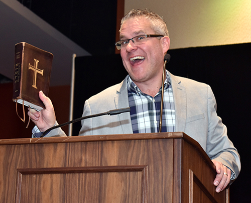 Bible teacher Mark Hart mugs for the camera during one of his talks at the Catechetical Conference in Miami.