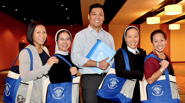 Five members of Our Lady of La Vang Vietnamese mission pause during the Catechetical Conference in Miami. From left are Jena Ho, Sister Phuong Van, Anthony Tran, Sister Quyen Nguyen, and Nhung Huynh-Kaloyios.