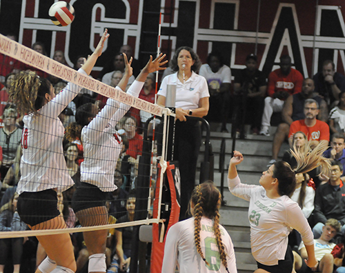 St. Brendan outside hitter Nataly Hernandez, right, tries to hit through Lake Highland Prep's block during Game 3 of St. Brendan's 25-15, 25-19, 25-21 loss to No. 1-ranked Orlando Lake Highland Prep in the teams' Class 4A state semifinal girls volleyball match at Wang Gymnasium in Orlando, Nov. 9, 2019. St. Brendan had reached the state semifinals for the first time since a state finals berth in 1980.
