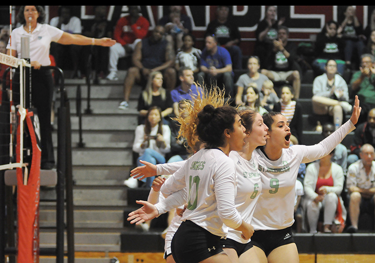 St. Brendan players (from left) Emily Diaz, Katerina Jimenez and Isabella Kouri celebrate a point during Game 3 of St. Brendan's 25-15, 25-19, 25-21 loss to No. 1-ranked Orlando Lake Highland Prep in the teams' Class 4A state semifinal girls volleyball match at Wang Gymnasium in Orlando, Nov. 9, 2019. St. Brendan had reached the state semifinals for the first time since a state finals berth in 1980.
