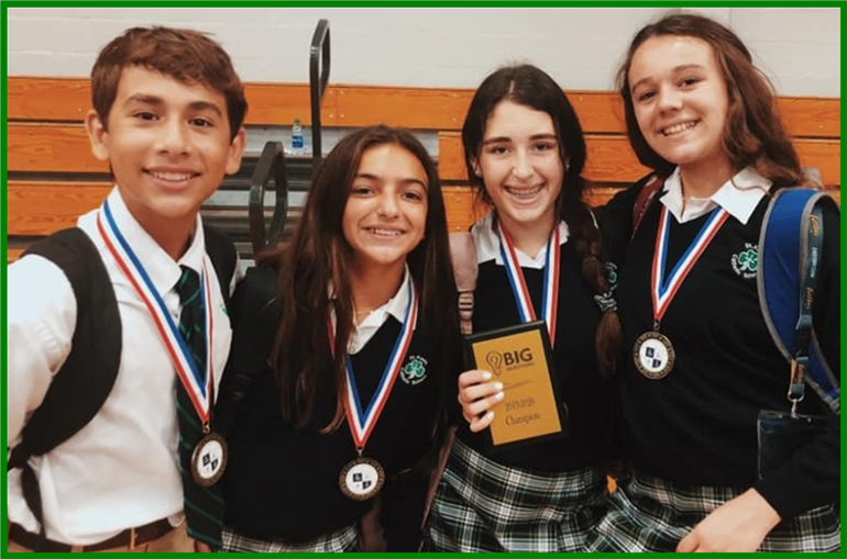 Some of the winners from St. Kevin School pose with the medals and trophies they won at Christopher Columbus High School's academic olympics competition.