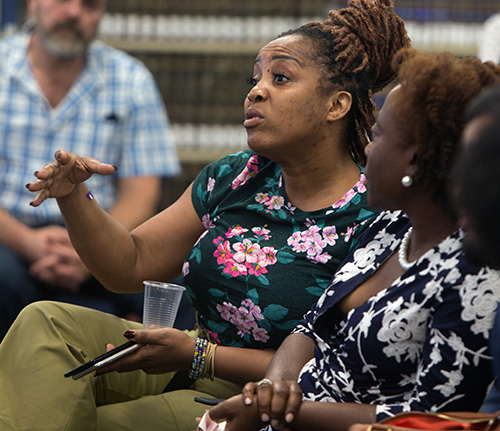 An audience member asks a question during the talk on domestic violence given by Susan Buzzi, victims advocate,  educator, and retired police officer, at St. Thomas University Oct. 17, 2019.
