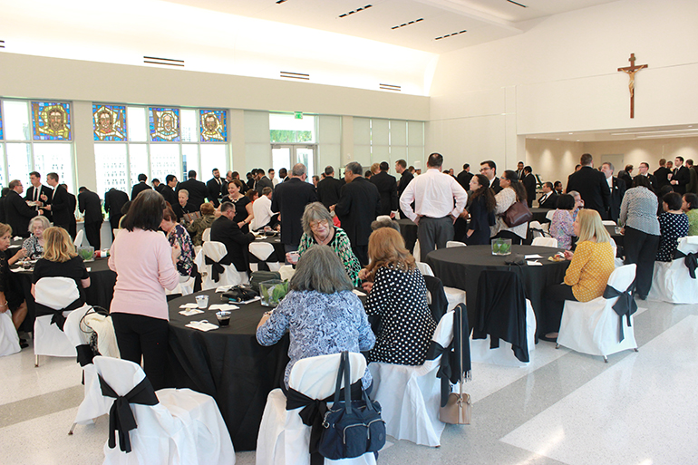 View of the new refectory and guests enjoying the reception that followed the blessing. The seminary is marking the 60th anniversary of its foundation this year.