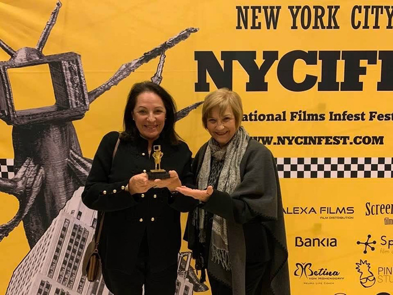 Carmen Valdivia, left, and Carmencita Romanach, of Operation Pedro Pan Group, pose with the award for best document feature film awarded by the 2019 New York City International Films Infest Festival.