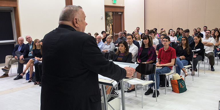 Archbishop Thomas Wenski addresses a University of Miami forum on