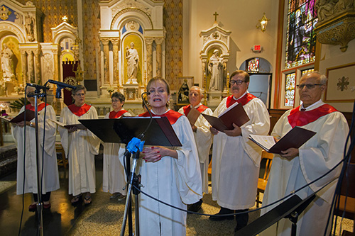 Cristina Arias leads the St. John Neumann Church Festival Choir during the annual Red Mass, celebrated by Archbishop Thomas Wenski for the Miami Catholic Lawyers Guild Oct. 24, 2019 at Gesu Church, Miami.