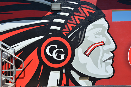A close up shot of the chief element of the Chief mural, designed by renowned marine-life artist and Cardinal Gibbons alumnus Dennis Friel '92, that was installed on the south side of the high school's baseball dugout in honor of the Gunther family.
