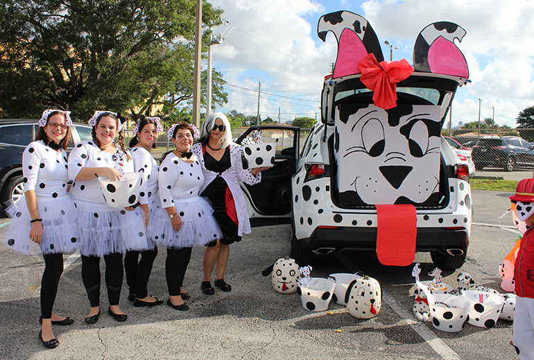 More spots than a Dalmatian: Faculty members from St. Michael the Archangel School, including school Principal Carmen Alfonso (second from right), took Disney's 101 Dalmatians quite seriously at this year's trunk or treat event Oct. 31. The entire car exterior was decked out in spots.