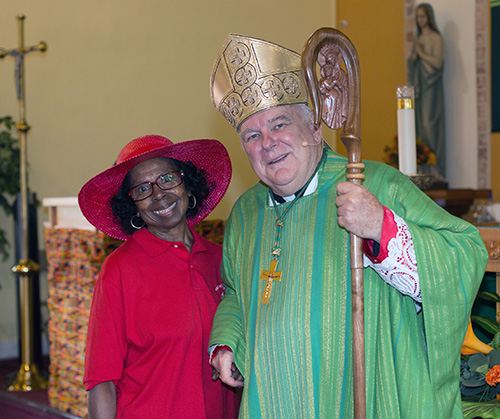 Lona Bethel Matthews poses with Archbishop Thomas Wenski after the Mass he celebrated for Black Catholic History Month, Nov. 3, 2019, at St. Philip Neri Church, Miami Gardens.