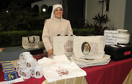 Discalced Carmelite postulant Tita del Niño Jesus sells merchandise, including the homemade candied nuts made by the nuns, at the contemplative concert at Immaculate Conception Church in Hialeah Nov. 6 benefiting the Discalced Carmelites and the completion of their Monastery of the Most Holy Trinity in Homestead.