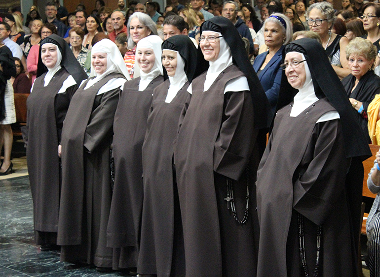 The Discalced Carmelite nuns and novices are all smiles as they are recognized at the contemplative benefit concert held at Immaculate Conception Church in Hialeah Nov. 6 to raise funds for the remaining work of their  Monastery of the Most Holy Trinity in Homestead.