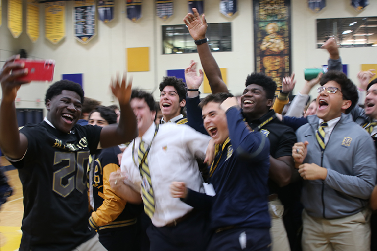 Belen Jesuit Don Chaney Jr. takes a selfie with his varsity football teammates during the pep rally where he received his All-American Bowl football jersey - the first player in Belen history to be selected.